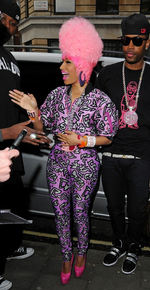 Nicki Minaj Nicki Minaj is all smiles as she is seen at BBC radio 1 in a purple patterned lycra cat suit signing autographs for waiting fans.