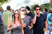 Nicky Hilton and boyfriend David Katzenberg grab some cool drinks while attending day one of the Coachella Valley Music and Arts Festival. They are also joined by Brandon Davis.