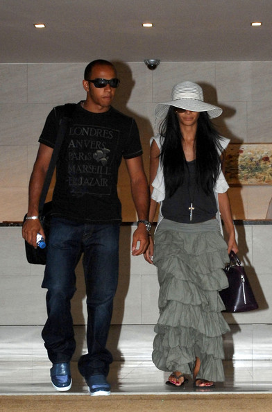Lead singer of The Pussycat Dolls Nicole Scherzinger and her boyfriend Lewis Hamilton are spotted leaving their hotel together.