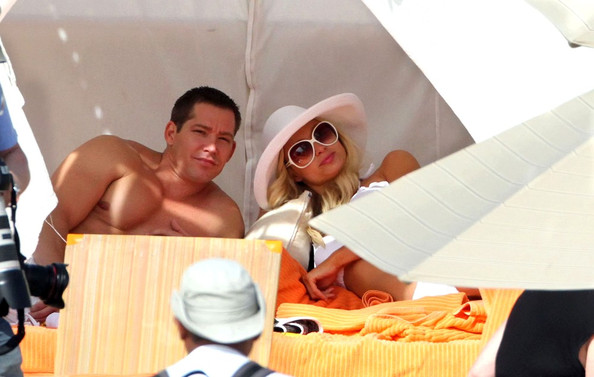 Paris Hilton relaxes in the sun on the beach with boyfriend, Cy Waits. The pair seem very much in love as they kiss by the ocean.