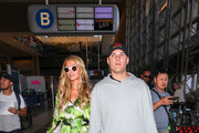 Paris Hilton and Chris Zylka are seen at Los Angeles International Airport in Los Angeles, California on June 8, 2018.