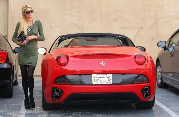 Paris Hilton Paris Hilton visits the chiropractor in her $280k Ferrari California wearing a skintight backless dress that reveals her form.
