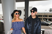 Paris Hilton and Chris Zylka are seen at Los Angeles International Airport in Los Angeles, California on May 11, 2018.