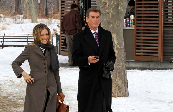 "Sarah Jessica Parker and Pierce Brosnan share some laughs while filming ""I Don't Know How She Does It"" in Battery Park."