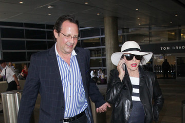 Percy Gibson Joan Collins And Husband Percy Gibson Hit LAX