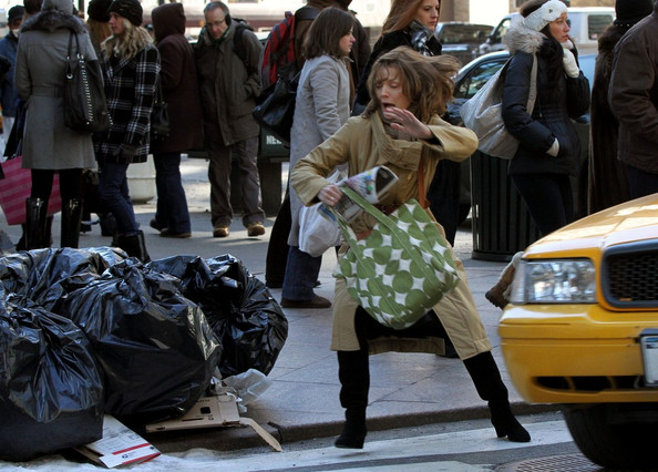 Michelle Pfeiffer lands face down in a pile of trash whilst filming scenes for 'New Year's Eve'.