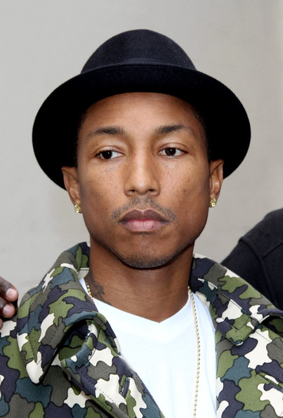 Pharrell Williams Pharrell Williams and DJ Mark Ronson join the Orange RockCorps movement in Boulogne Billancourt.