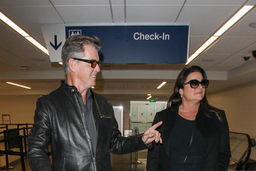 Pierce Brosnan Pierce Brosnan and Wife Keely Shaye Smith at LAX