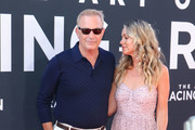 Kevin Costner  is seen attending at the Premiere of 20th Century Fox's 'The Art Of Racing In The Rain' held at El Capitan Theatre in Los Angeles, California.