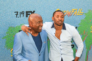 John Singleton and Malcolm Mays are seen arriving at the premiere of FX's 'Snowfall' Season 2 at the Regal Cinemas L.A. LIVE Stadium 14 in Los Angeles, California.