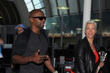 Rebecca Crews Terry Crews and Rebecca Crews at LAX