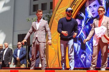 Robert Downey Jr. Chris Hemsworth Marvel Studios' 'Avengers: Endgame' Cast Place Their Hand Prints In Cement At TCL Chinese Theatre IMAX Forecourt