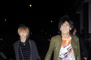 Ronnie Wood and girlfriend Ekaterina Ivanova are spotted out and about in London. Ronnie smiles happily at photographers while Ekaterina ducks her head and accidentally runs into a lamppost.