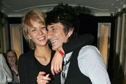 Ronnie Wood and girlfriend Ekaterina Ivanova have fun with friends at Claridges Hotel. After having a fair share of drinks they continue the revelry out on the streets where they stop outside a toilet shop and poke fun at the window display.
