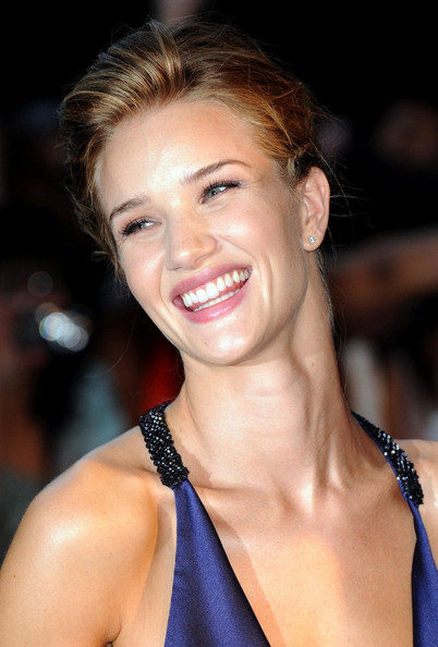 "Rosie Huntington-Whitley dazzles in a blue gown as she arrives for the premiere of ""Transformers: Dark of the Moon.""."