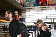 Russell Brand and His Family Enter LAX