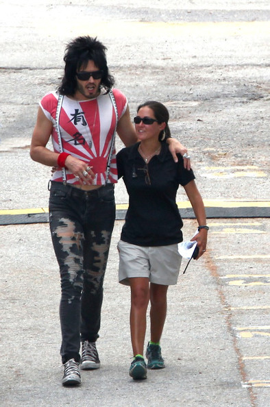 "Russell Brand in costume as he films his latest movie ""Rock of Ages"" which also stars Alec Baldwin and Tom Cruise. Russell seemed in a great mood strolling arm in arm with a young crew member and also his bodyguard."