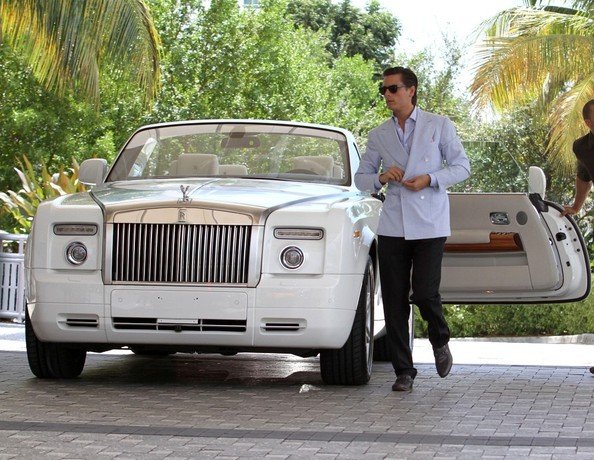 ***NO CANADA RIGHTS***.Scott Disick leaves his white Rolls-Royce with the valet as he returns to his hotel wearing a blue blazer and black pants.