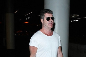 Simon Cowell Simon Cowell is Seen in Sunglasses at LAX