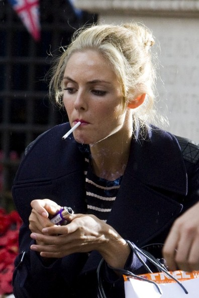 Tamsin Egerton smoking a cigarette (or weed)