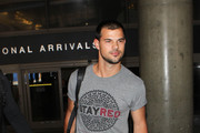 Taylor Lautner Arrives at LAX