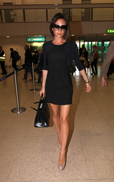 Victoria Beckham Victoria Beckham continues to flaunt her toned legs as she