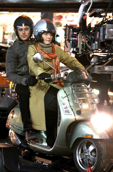 "Zac Efron and Michelle Pfeiffer take turns driving a scooter while filming ""New Years Eve"" in Times Square."