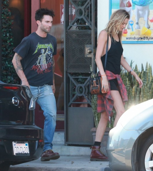 Newlyweds Adam Levine and Behati Prinsloo out shopping for watches in West Hollywood, California on August 16, 2014. Behati was dressed like a rocker chick as they exited the store and got into Adam's Porsche.