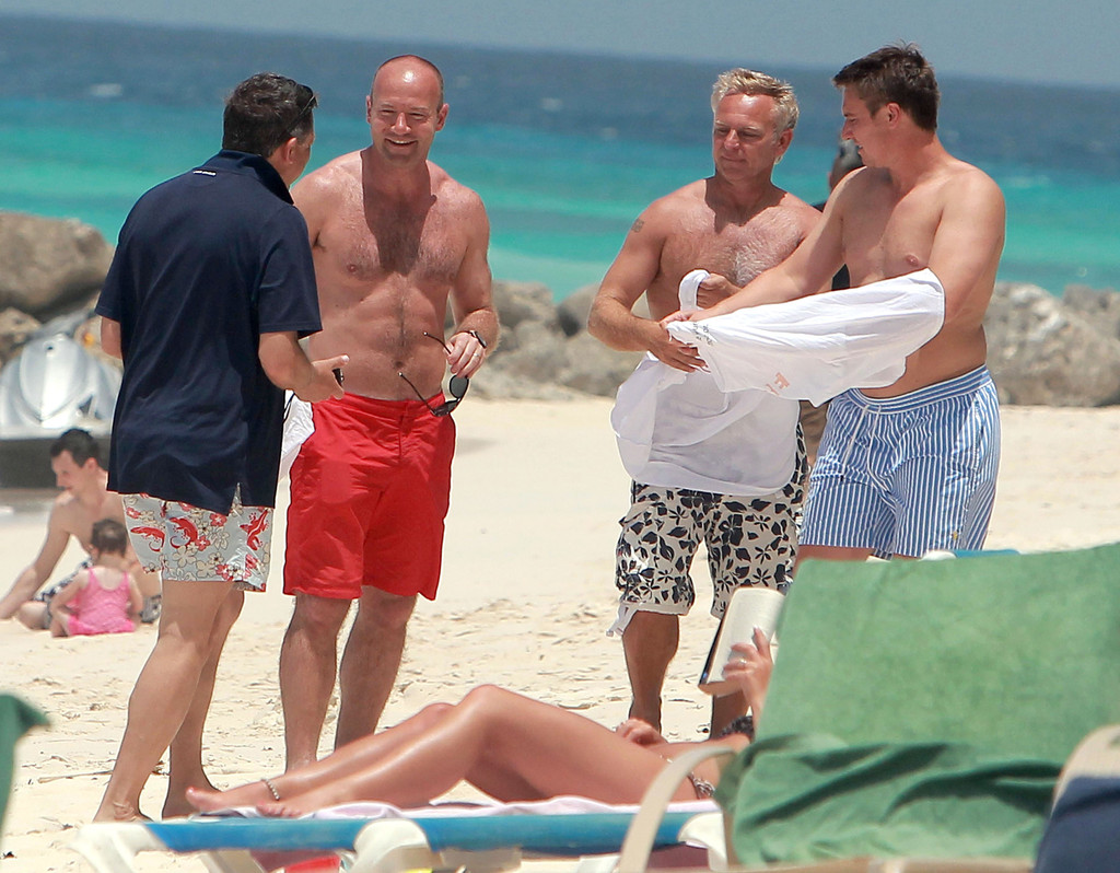 Alan Shearer takes a dip in the Caribbean during a family