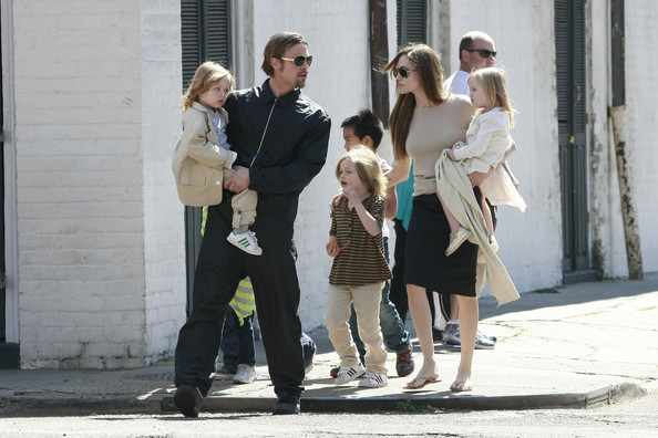 Angelina Jolie Brad Pitt and Angelina Jolie take out all 6 of their children to the corner store near their home in New Orleans LA.  Brad held son Knox and Angelina held onto his twin Vivienne as the clan walked to the deli Verti Marte on the corner.
