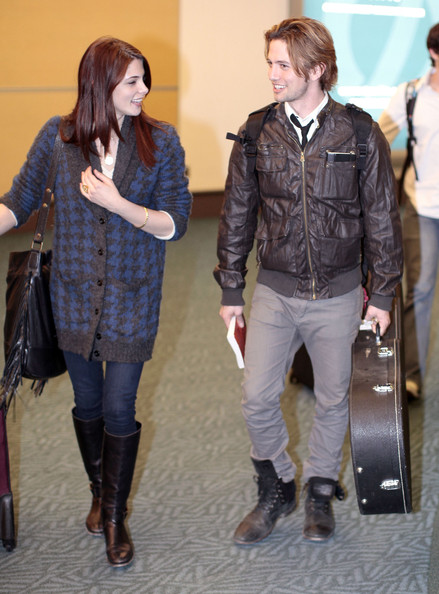 Ashley Greene Actress Ashley Greene and Jackson Rathbone arriving on a flight from Los Angeles in Vancouver, Canada. The pair are in town to film 'The Twilight Saga: Breaking Dawn'