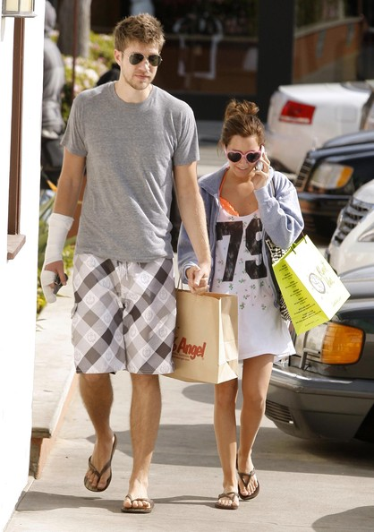 Actress Ashley Tisdale and her boyfriend Scott Speer out shopping at Planet Blue and 98% Angel in Malibu, CA. Ashley is wearing some stylish heart sunglasses and Scott is wearing a bandage that covers his hand from some broken fingers.