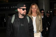 """Actress Cameron Diaz and her husband Benji Madden land on a flight from Australia at LAX Airport on August 31, 2015 in Los Angeles, California. The couple were joined by Benji's brother Joel and British singer Jessi J, who beat the twins on Australia's """"The Voice."""""""