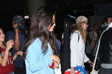 Cara Delevingne Selena Gomez & Cara Delevingne Arriving On A Flight At LAX