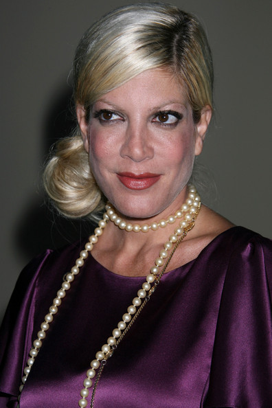 Tori Spelling, pulled back and in a bun: