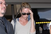 Charlize Theron Arriving on a Flight at LAX