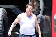 Reality star Chaz Bono feeds a meter while out and about in Hollywood, California on August 5, 2014. Chaz has been slimming down in hopes of getting an acting gig.