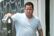Reality star Chaz Bono feeds a meter outside an acting class in Los Angeles, California on July 29, 2014. Chaz has been slimming down in hopes of getting an acting gig.
