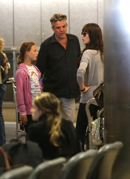 Danny Huston and Olga Kurylenko Touch Down at LAX