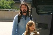 Rocker Dave Grohl and his daughter Violet departing on a flight at the Washington Reagan Airport in Washington DC on August 9, 2015. Dave has teamed up to join Johnny Depp's super group Hollywood Vampires.