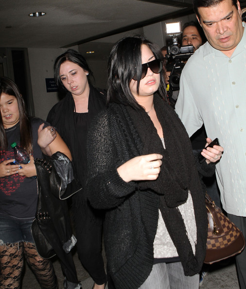 Demi Lovato Actress Demi Lovato shields her face as she arrives on a flight at LAX airport in Los Angeles. The actress has sprained her ankle. Demi recently donated million dollars to the Japan tsunami relief.