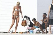 Model Doutzen Kroes and her husband Sunnery James go to the beach with their son Phyllon and daughter on January 1, 2017 in Miami, Florida.  The group enjoyed getting some sun and then wading in the ocean. Phyllon was less enthused by the ocean and stayed back by their towels.