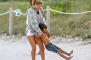 Model Doutzen Kroes and Sunnery James take their two kids Phyllon and Myllena to the beach in Miami, Florida on January 2, 2016.