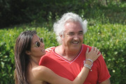 Formula One manager Flavio Briatore and his wife Elisabetta Gregoraci enjoy their weekend relaxing in the sun and playing soccer with friends in Sardinia, Italy on June, 30, 2012. Elisabetta showed off her bikini body while soaking up the sun. To cool off, she took a quick dip in the pool before heading to the field to kick the ball around.