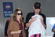 Emily Blunt & Family Arriving On A Flight At LAX