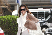 Eva Longoria is all smiles as she arrives at LAX in Los Angeles, California on October 20th, 2012.