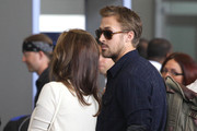 Couple Eva Mendes and Ryan Gosling arriving for a flight at LAX airport in Los Angeles, CA on June 2, 2012.