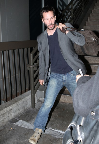 "Actor Keanu Reeves looks a little worse for wear as he arrives on a flight at LAX airport in Los Angeles. ""The Matrix"" star got an early start on his 47th birthday today by getting a little typsy on his flight."