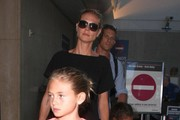 Heidi Klum Touches Down At LAX With Her Family