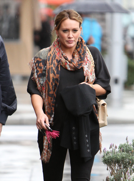 Hilary Duff Pregnant actress Hilary Duff heads out into the rain after eating lunch at a restaurant on February 15, 2012 in Beverly Hills, CA.